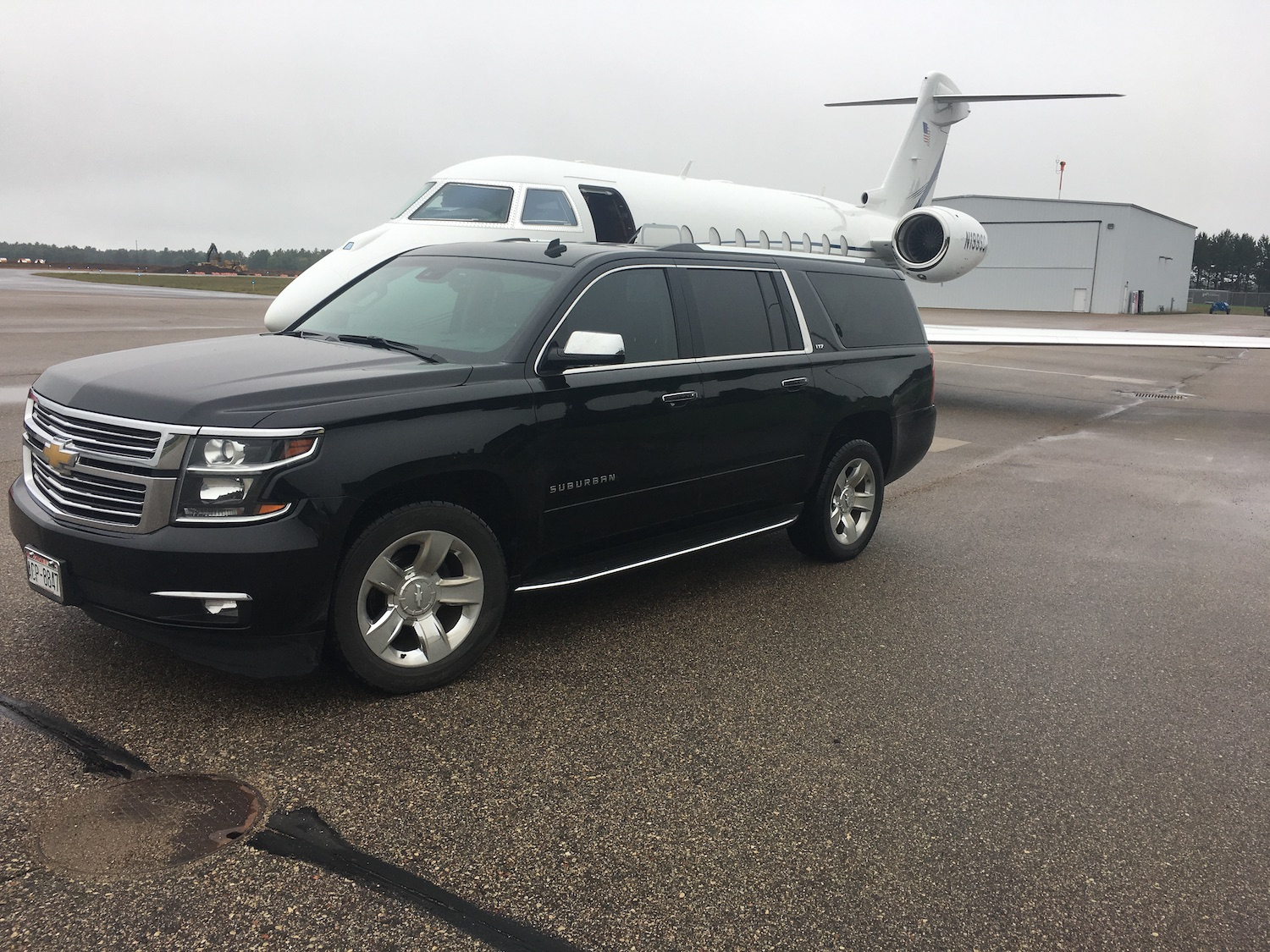 Black Suburban limo service for airport shuttle